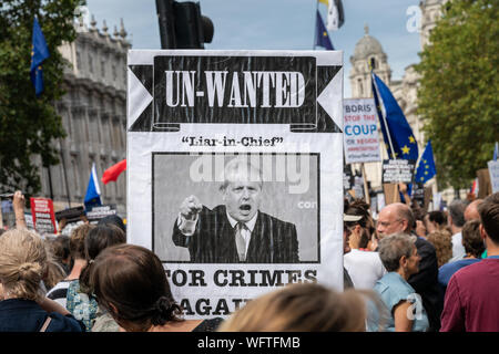 31th Aug 2019 - London, UK. An Anti-Brexit protesters hold up a placard of Boris Johnson reading 'Un-Wanted' outside Downing street at Whitehall. - Stock Photo