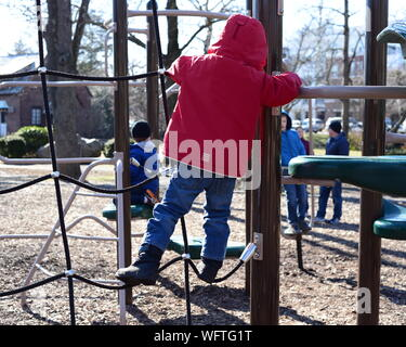 Full Length Rear View Of Child Climbing On Jungle Gym - Stock Photo