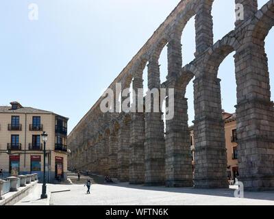 SEGOVIA, SPAIN - APRIL 25, 2018: View of the famous Roman Aqueduct in Segovia. - Stock Photo
