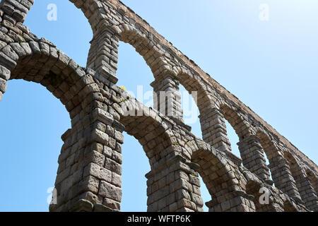 SEGOVIA, SPAIN - APRIL 25, 2018: Details of the Roman Aqueduct in Segovia. - Stock Photo