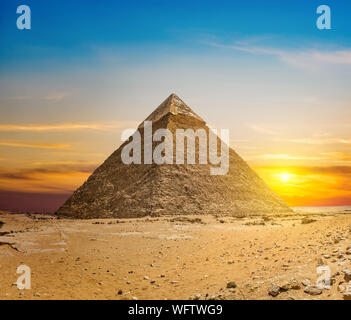 Chefren pyramid at sunset in the desert of Giza, Egypt - Stock Photo