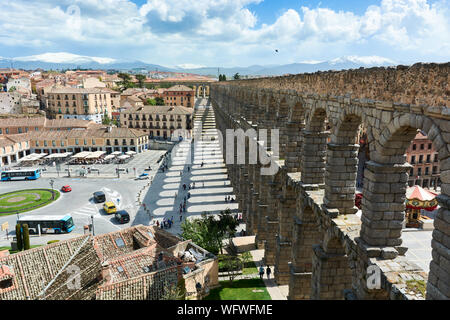 SEGOVIA, SPAIN - APRIL 25, 2018: View of the Roman Aqueduct and cityscape in Segovia. - Stock Photo