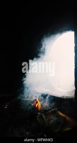 High Angle View Of Smoke Emitting From Fire - Stock Photo