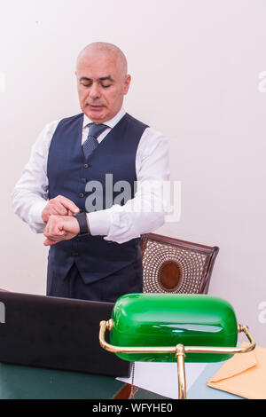 Bald Businessman Checking Time At Office - Stock Photo