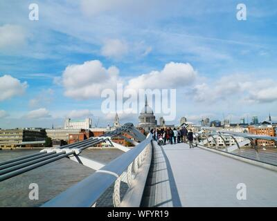 Millennium Bridge Over River Leading Towards St Pauls Cathedral - Stock Photo