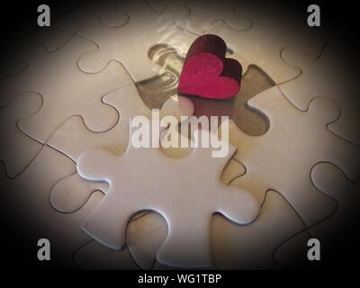 Red Heart Shape On Jigsaw Puzzle - Stock Photo