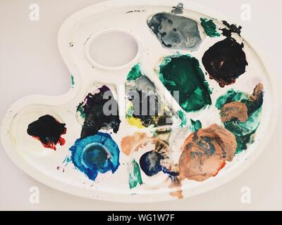 Close-up Of Multi Colored Paints In Palette On Table