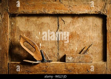Close-up Of Old Planes On Weathered Wooden Niche - Stock Photo