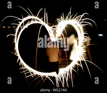 Close-up Of Heart Shape Light Painting At Night