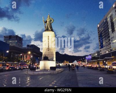 Low Angle View Of Admiral Yi Sun-shin Statue In City Against Sky - Stock Photo