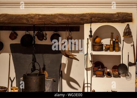 Kitchen Utensils Hanging On Wall - Stock Photo