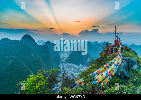 Scenic View Of Sunset Over Karst Mountains And Prayer Flag - Stock Photo