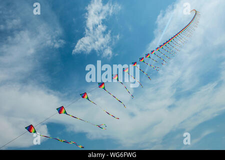 Low Angle View Of Multi Colored Kites Against Sky