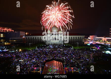 Firework Display Over Palace Of Justice At Night - Stock Photo
