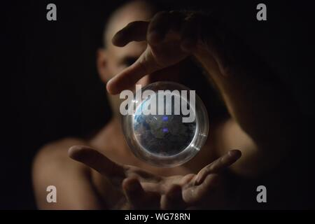 Magician Showing Trick With Globe - Stock Photo