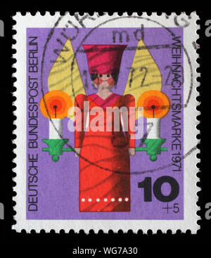 Stamp issued in Germany - Berlin shows a turned wooden Christmas angel, Christmas series, circa 1971. - Stock Photo