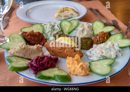 Turkish Mezzer Platter with a variety of foods and vegetables - Stock Photo