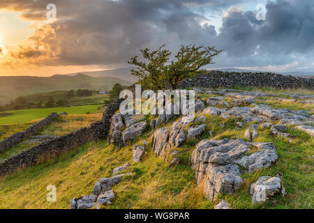 Stormy sunset over a small limestone pavement at the Winskill Stones near Settle in the Yorkshire Dales
