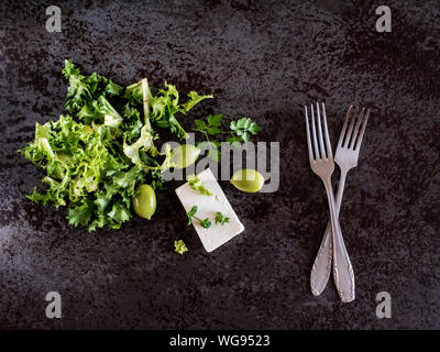 Directly Above Shot Of Feta Cheese With Olives And Green Herbs On Marble Counter - Stock Photo