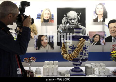 Moscow, Russia. 01st Sep, 2019. MOSCOW, RUSSIA - SEPTEMBER 1, 2019: A photographer at the TASS Russian news agency headquarters in central Moscow as the agency celebrates the 115th birthday. Valery Sharifulin/TASS Credit: ITAR-TASS News Agency/Alamy Live News - Stock Photo