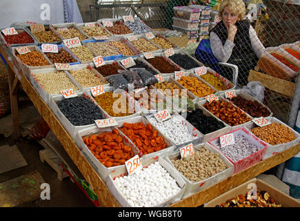 Cholpon Ata, Kyrgyzstan - August 20, 2019: Dried fruits and nuts on display on a market in Cholpon Ata, Kyrgyzstan. - Stock Photo