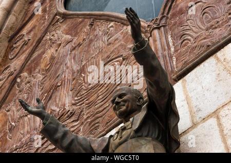 Low Angle View Of Pope John Paul Ii Statue At Basilica Del Voto Nacional - Stock Photo