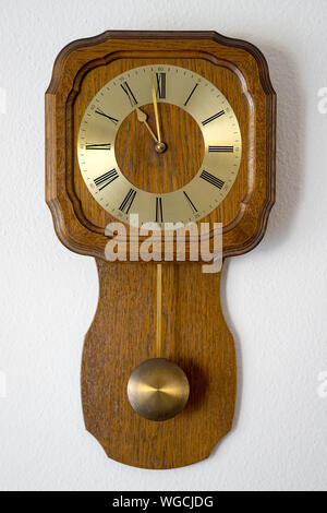 Close-up Of Antique Wall Clock Against White Wall - Stock Photo