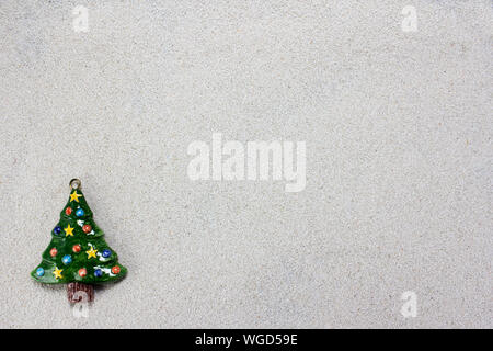 Close-up Of Artificial Christmas Tree On Wall - Stock Photo
