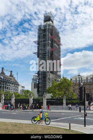 Scaffolding around Elizabeth Tower for restoration, renovations, repairs at Palace of Westminster, London, UK. Big Ben London. Covered in scaffolding. - Stock Photo