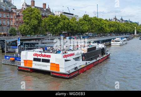 City Cruises sightseeing boat for sightseers seeing London by boat from the River Thames at Westminster Pier, Westminster, London, England, UK. - Stock Photo