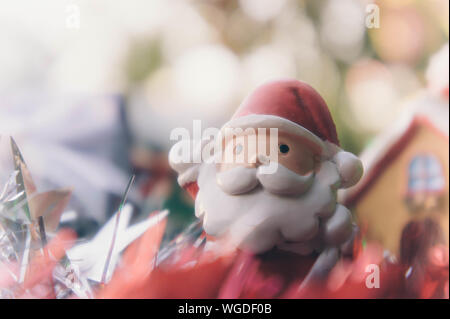 Close-up Of Santa Claus Figurine By Christmas Decorations On Table