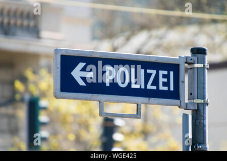 Low Angle View Of Police Sign With Arrow Symbol - Stock Photo