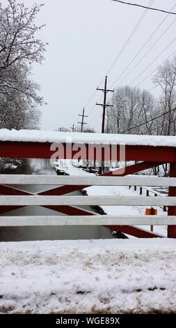 Fence Covered With Snow Against Sky - Stock Photo