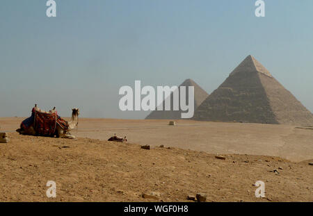 Giza Pyramids On Desert Against Clear Sky - Stock Photo
