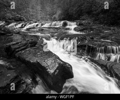 Water flowing around one of the many large rock formations along Big Panther Creek. Big Panther Creek is a tributary of the Tallulah River in northern - Stock Photo