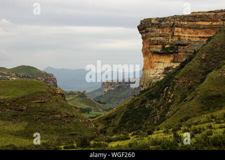 The Brandwag Buttress, a steep Sandstone cliff, standing watch over the entrance of the valley on an overcast day, Photographed in Golden Gate, SA - Stock Photo