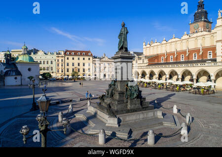 Bronze statue of Adam Mickiewicz, Polish national romantic poet and dramatist on Main Market Square in Krakow, Poland. Monument unveiled in 1898. St. - Stock Photo