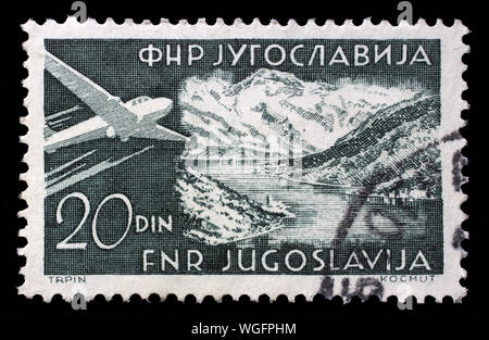 Stamp issued in Yugoslavia shows Bay of Kotor, Airplanes and Landscapes series, circa 1951. - Stock Photo