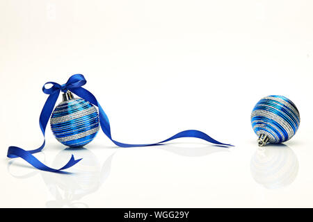 Blue Christmas ball with ribbon bow Isolated on white background - Stock Photo