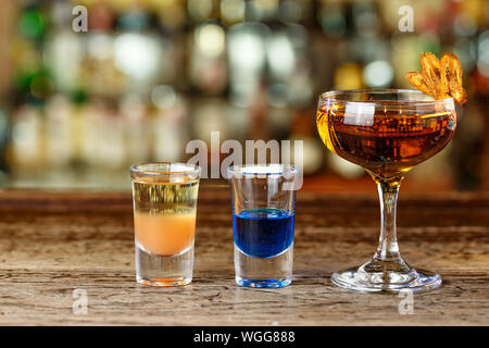 A lot of cocktails on the bar. Multicolored alcoholic Drinks stand on the bar. Space for text - Stock Photo
