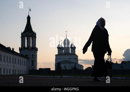 YAROSLAVL REGION, RUSSIA - AUGUST 18, 2019: A woman by the Spaso-Yakovlevsky Monastery [Monastery of St Jacob Saviour] in the town of Rostov Veliky. Dmitry Feoktistov/TASS - Stock Photo