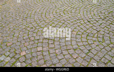 Ancient granite paved stones texture in Peter and Paul fortress, St Petersburg, Russia. Pavement pattern background laid in an circular arc - Stock Photo