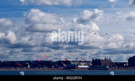 Multi Colored Kites Over Sea Against Sky