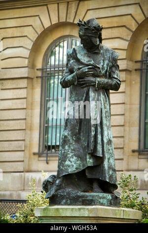 Paris, France - July 7, 2019: Dante statue near the College de France in Paris - Stock Photo