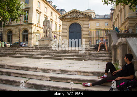 Paris, France - July 7, 2019: Claude Bernard statue in front of the main entrance to the College de France in Paris - Stock Photo