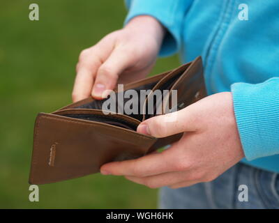Cropped Image Of Man Holding Empty Wallet - Stock Photo