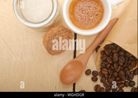 Directly Above Of Coffee With Ingredients On Table - Stock Photo