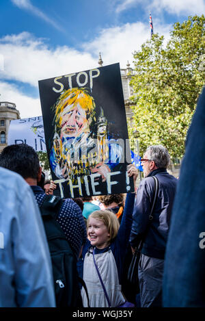 Anti Boris Johnson placard, Little girl carrying hand made placard showing Boris Johnson as Thief, Protest against the suspension of Parliament, London, UK, 31/08/2019 - Stock Photo
