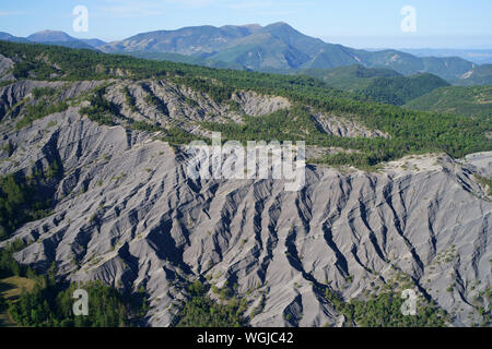 RAVINES AND WOODED AREA NEAR THE CITY OF DIGNE-LES-BAINS (aerial view). Archail, Alpes de Haute-Provence, France.