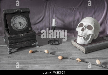 Antique Clock With Candlestick Holder And Skull - Stock Photo